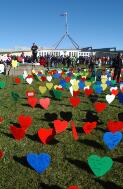 [Section of the field of hearts display and portion of the crowd in front of Parliament House, United Nations World Refugee Day and Field of Hearts event, Canberra, 20 June 2004] Loui Seselja
