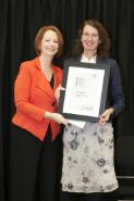 Prime Minister Julia Gillard presenting novelist Roberta Lowing with her award at the Prime Minister's Literary Awards held at the National Library of Australia, Canberra, 8 July 2011 / Sam Cooper
