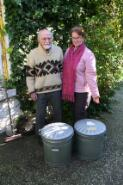 Dr Phillip Law and Helen Morgan standing in front of two steel bins filled with Dr Law's diaries and notebooks, 2006 / Gavan McCarthy