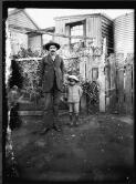 [Man standing with a small Aboriginal boy] [William Henry Corkhill]