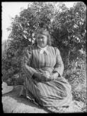 [Aboriginal woman in the Corkhill's back garden] [William Henry Corkhill]