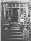 Portrait of Anna Pavlova on steps outside a conservatory