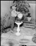 Mulligan, J. A. (John Aloysius), 1927-1996. Dawn Lake pouring water into bird bath, in her new show, Killara and Channel 9, 25 September, 1963 [picture]/