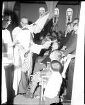 Mulligan, J. A. (John Aloysius), 1927-1996. Children with a disability being blessed during confirmation at Blessed Sacrament Church, Clifton Gardens, 21 October, 1967 [picture] /