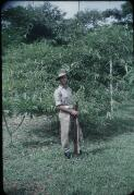 Spencer, Terence E. T. Kit Denton, in uniform, is holding a gun Port Moresby, Papua New Guinea, 1953 [picture] /