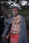[Doonooch Dance Company performer Goodju Goodju with blanket and clapsticks - Botanical Gardens, Sydney, 18 August 2000, 1] Loui Seselja