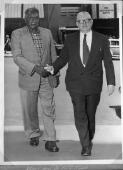 Albert Namatjira shaking Dr.H.V. Evatt's hands [picture].