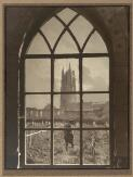 Hurley, Frank, 1885-1962. Looking through a ruined cathedral window on to a battlefield cemetery [picture] /