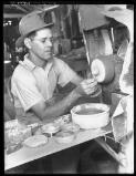 Hurley, Frank, 1885-1962. [Unidentified man with grinding wheel] [picture] /