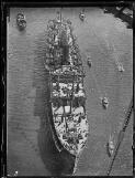 Large passenger ship passing under Sydney Harbour Bridge, New South Wales, 19 March 1932, 1