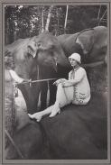 Photograph of Anna Pavlova, seated on an elephant during her tour of India, 1923